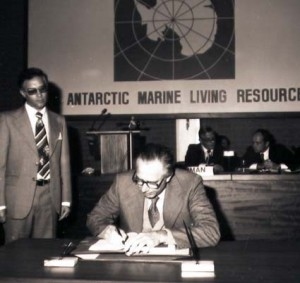 Antarctic marine living resources. Man at desk signing document.