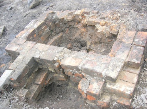 Foundation of brick chimney with two fireplace openings